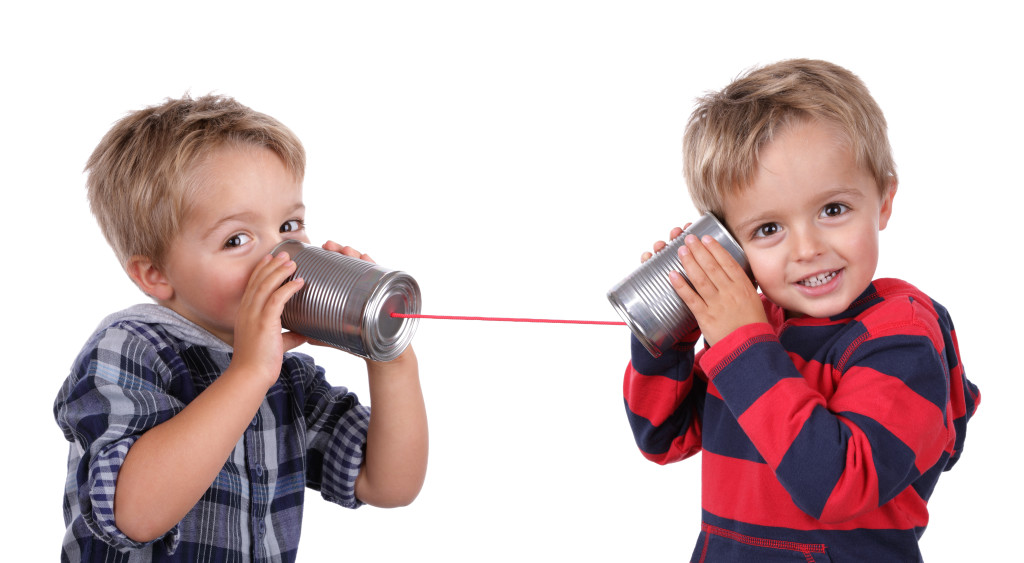 bigstock-Little-boy-playing-with-can-ph-38818474
